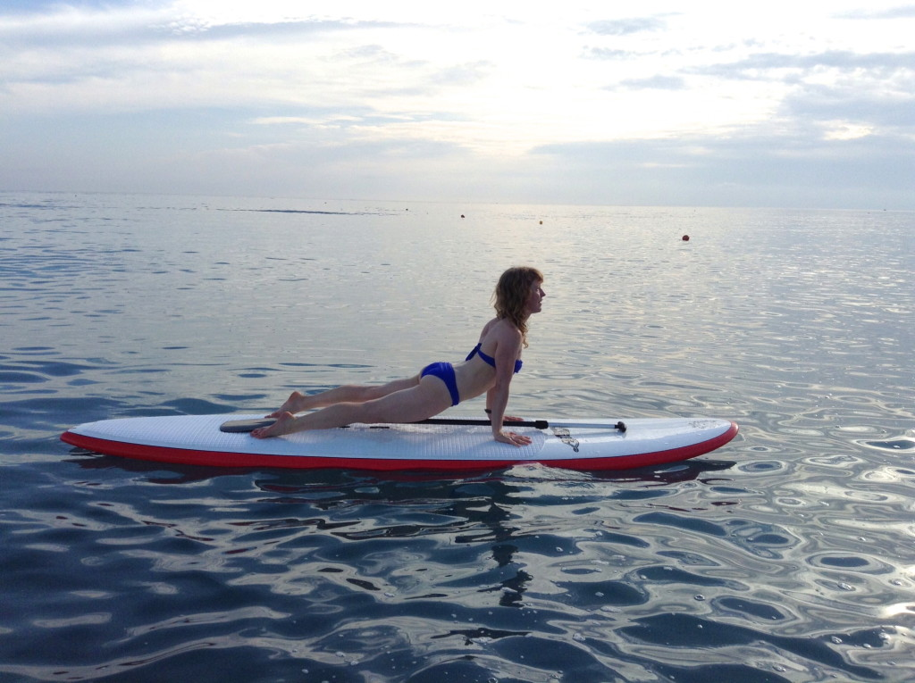 Luci Gabel, Updog Yoga on Paddleboard